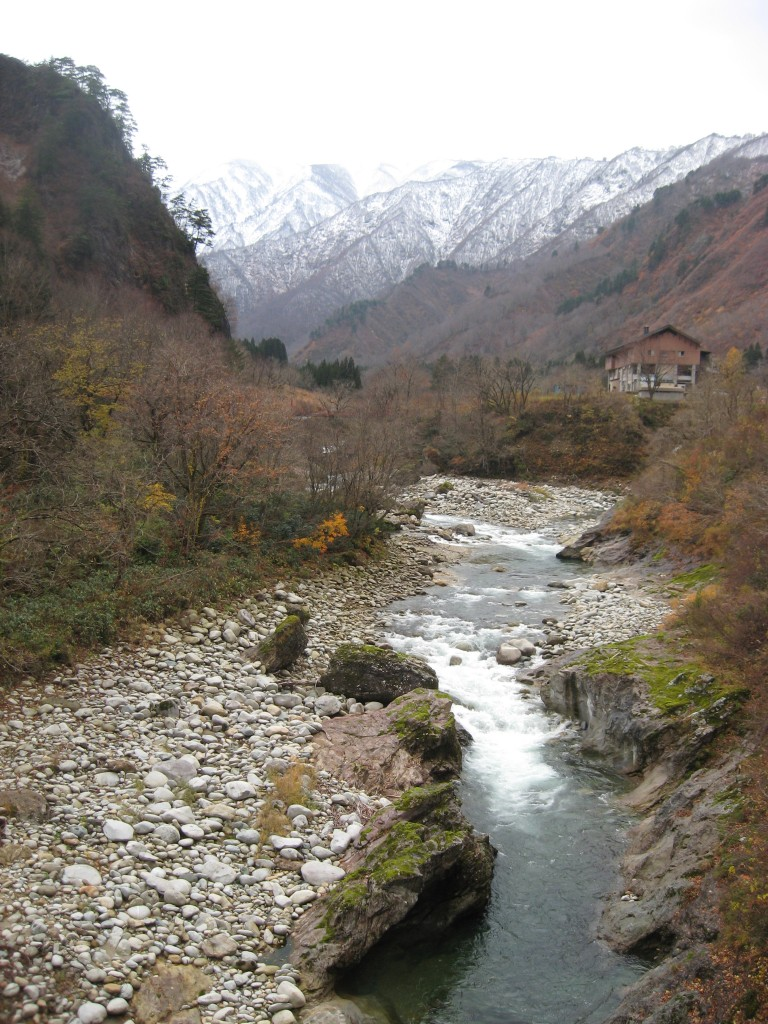 River in Yamagata and Snow Covered Mountains