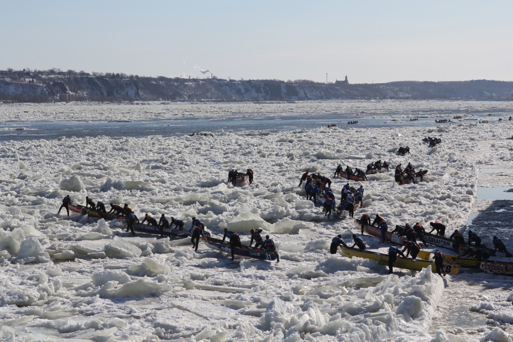 Ice canoeing- Dozens of teams make their way across the ice. Photo credit: Quebec Winter Carnival