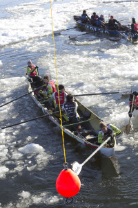 Canoer reaches for a marker.  Photo credit: Quebec Winter Carnival